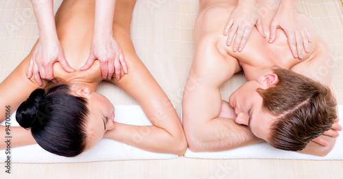 Fotografie, Obraz  Beautiful couple lying  in a spa salon.