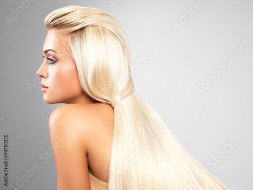 Vászonkép Blond woman with long straight hair