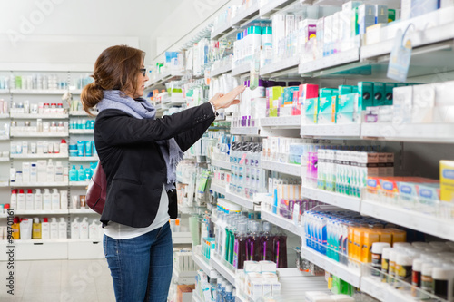 Photo Female Customer Choosing Product At Pharmacy