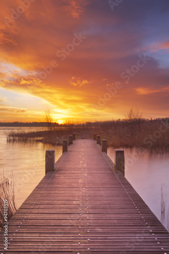 Fototapety, obrazy: Boardwalk over water at sunrise, near Amsterdam The Netherlands
