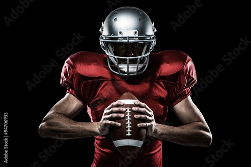 Composite image of american football player holding ball Fotobehang