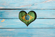 canvas print picture Love Brazil. Heart and flag on a blue wooden board