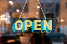 Open Vintage Wooden Sign Broad Through The Glass Of Store Window