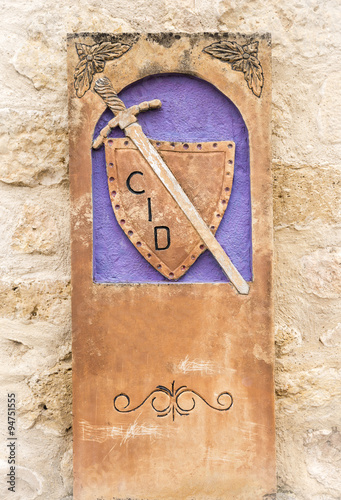 Photo  Camino del Cid signpost with a shield and a sword - Spain