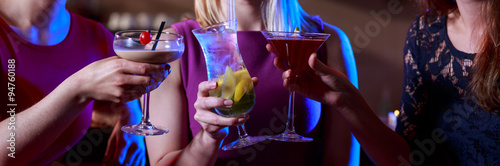 Three female friends toasting
