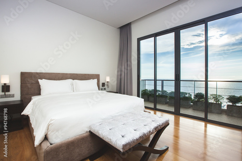 Fotografía  Modern comfortable, nicely decorated bedroom with seascape view
