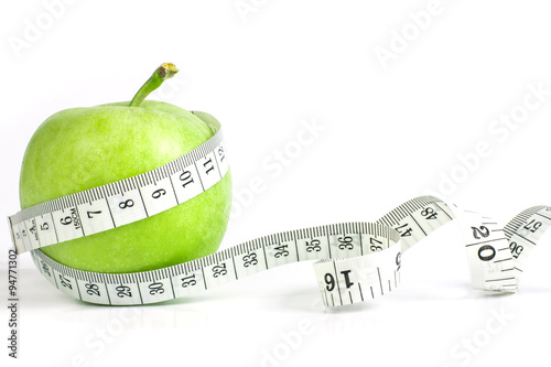 Fotografia  green apple with Measuring tape on diet concept