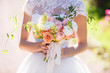 canvas print picture - beautiful wedding bouquet in the hands of the bride