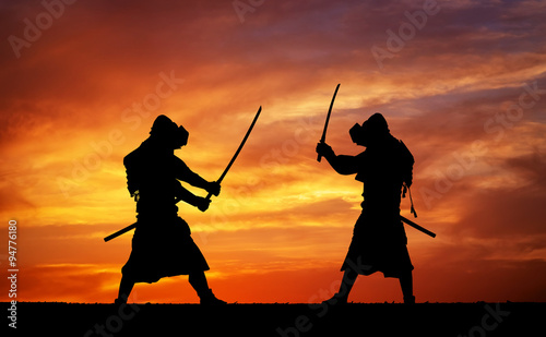 Silhouette of two samurais in duel. Canvas Print