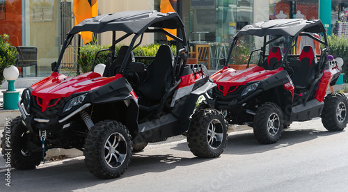 Poster Voitures rapides All-terrain vehicle rent on the street.