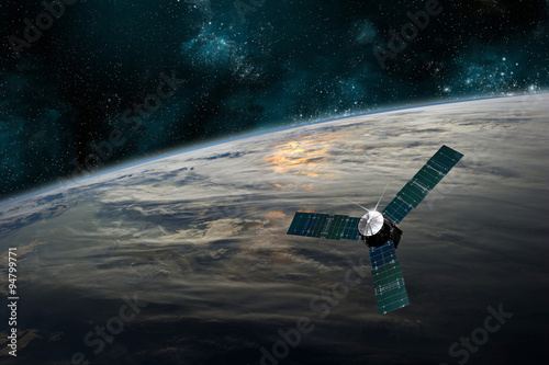 Obraz na plátne  A satellite orbits Earth - Elements of this image furnished by NASA