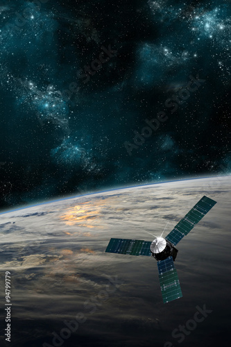 Fotografia, Obraz  A satellite orbits Earth - Elements of this image furnished by NASA