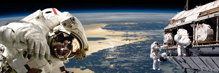 Naklejka A team of astronauts performing work on a space station.- Elements of this image furnished by NASA.