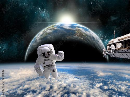 Fotografie, Obraz  A team of astronauts work on a space station - Elements of this image furnished by NASA