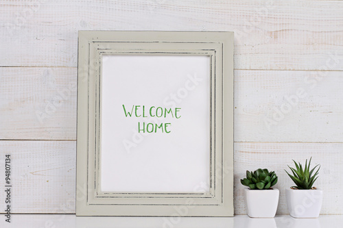 Home and family concept. Welcome home poster in frame rustic ...