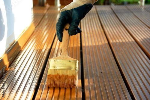 Holzterrasse Wird Mit Ol Behandelt Buy This Stock Photo And