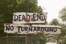 """Dilapidated Sign Reads """"Dead E"""