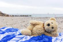 Teddy Bear / A Teddy Bear Lies On A Beach Towel On The Baltic Beach