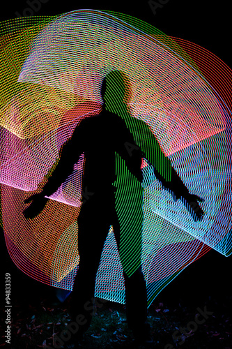 Photo  Silhouette in front of abstract freezelight background
