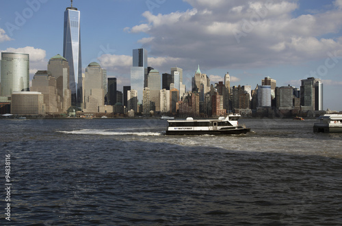 Foto op Aluminium New York From New Jersey, a water taxi is seen in front of New York City Skyline featuring One World Trade Center (1WTC), Freedom Tower, New York City, New York, USA, 03.20.2014