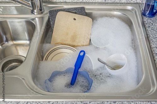 Dirty Kitchen Sink Dirty dishes in soapy water in a kitchen sink buy this stock photo dirty dishes in soapy water in a kitchen sink workwithnaturefo