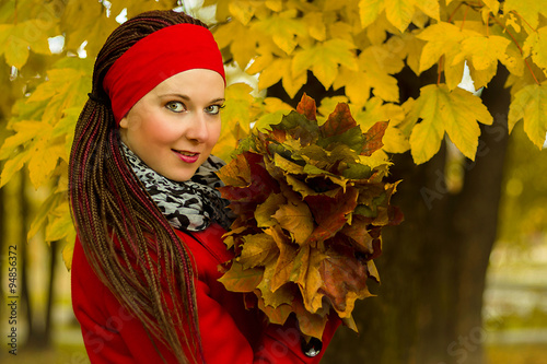 Woman with leaves in hairstyle with braids