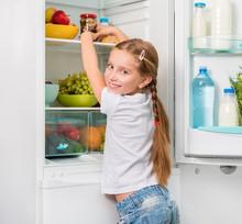 Little Girl Reaching A Jar Of ...