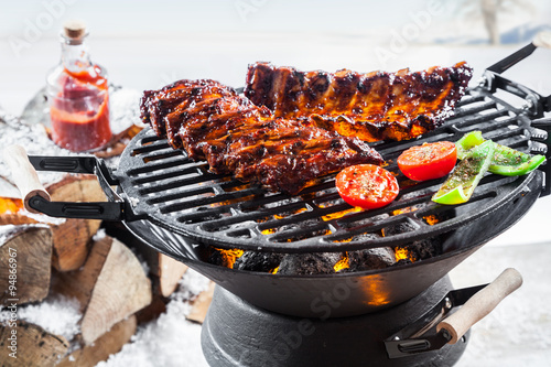Aluminium Prints Grill / Barbecue Spicy marinated spare ribs grilling outdoors