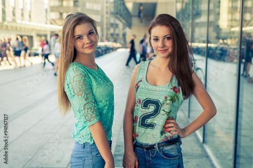 Fototapeta Two pretty girls. They're best friends. Outdoor photo. obraz na płótnie