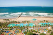 canvas print picture - Aerial view of Indian Ocean, white sandy beaches, pool and ocean pier in the town center of Durban, South Africa