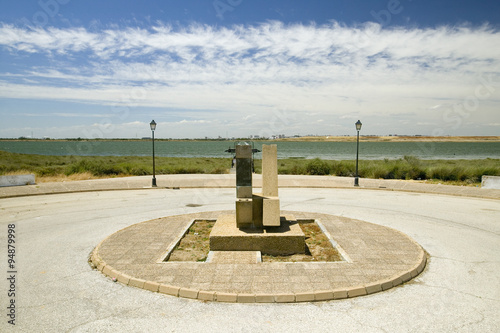 A Monument marking the precise spot where Christopher Columbus' fleet of three ships departed the harbour of Palos de la Frontera on 3 August 1492, with the Rio Tinto River and the opposite bank of the city of Huelva in the background, Southern Spain
