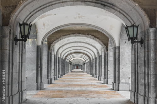 Fototapety, obrazy: Symmetrical corridor with rows of columns. Black and white picture.