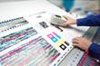 canvas print picture - オフセット印刷色見台で測色する作業者の手