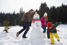 Happy Family Building Snowman