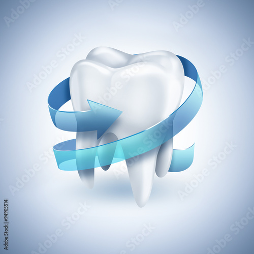 Valokuva  healthy white tooth with blue arrow