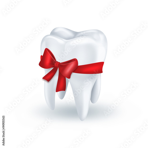Valokuva  tooth with red bow