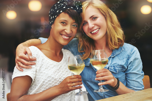 Fotografia, Obraz  Two gorgeous women enjoying a glass of wine