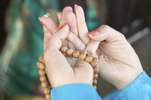 A Woman's Hands Hold Prayer Beads And Rice At An Amitabha Empowerment Buddhist Ceremony, Meditation Mount In Ojai, CA