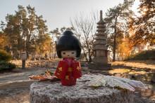 Japanese Traditional Dolls On A Background The Stupa. (mass-prod