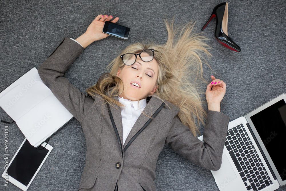 Fototapeta Overworked business woman