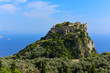 Distant view at Angelokastro castle with Paleokastratsa on background, Corfu, Greece.