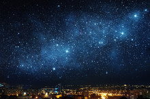 City Landscape At Nigh With Sky Filled With Stars. Elements Of This Image Furnished By NASA.