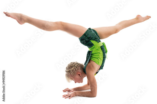 Foto auf AluDibond Gymnastik Young gymnast on a white background.