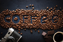 Coffee Word Made By Coffee Beans With Camera  Chocolate And Cup Of Coffee