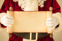 Santa Claus Holding Scroll Pap...