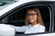 Female driver driving a car