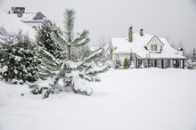A Private House And Its Garden Under Snow In Winter