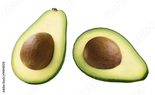 Double avocado half with seed isolated on white