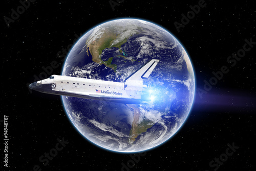 Deurstickers Nasa Space shuttle flying in outer space - Elements of this image furnished by NASA