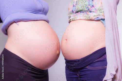 Poster Akt Two pregnant friends, showing belly, are waiting for their children